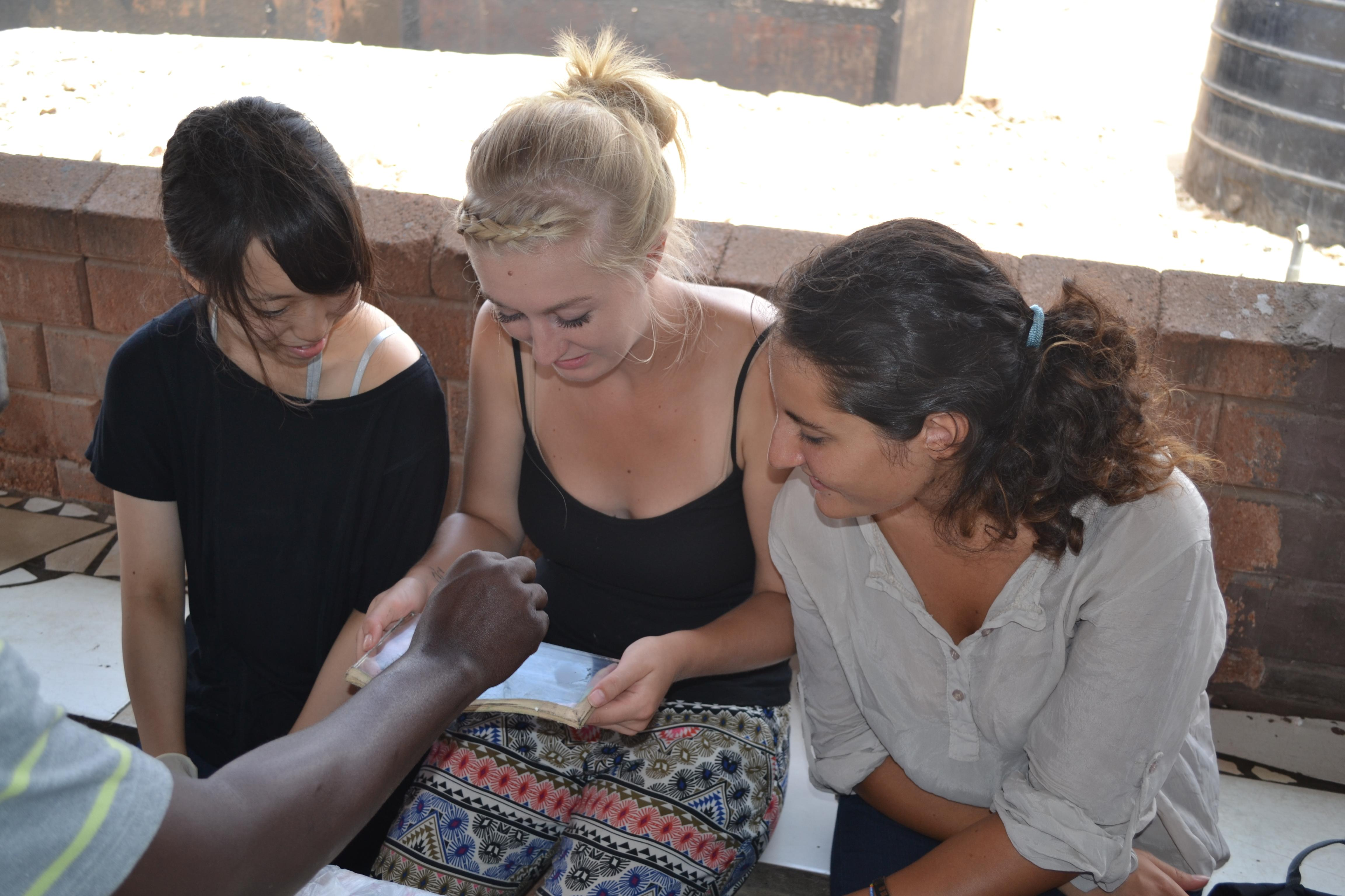 HIV/Aids interns in Ghana learn how to check blood samples before a medical outreach in Accra.
